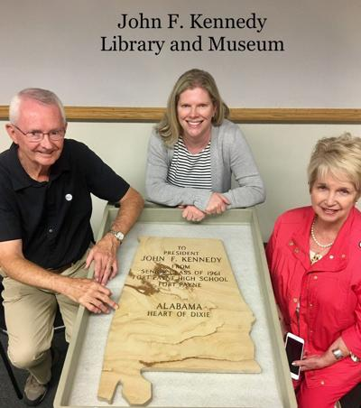 Cole views Fort Payne High School carving at Kennedy Museum