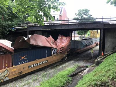 update csx train slams west side bridges local news