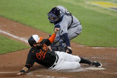 Santander hits unique HR, has 3 RBIs as Orioles top Rays 6-3