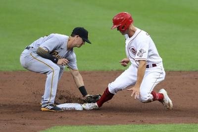 Gray fans 10, Winker homers twice as Reds beat Pirates 8-1