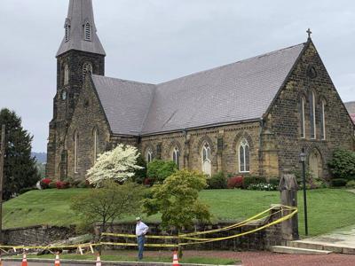 Emmanuel Episcopal Church replacing ancient stone wall