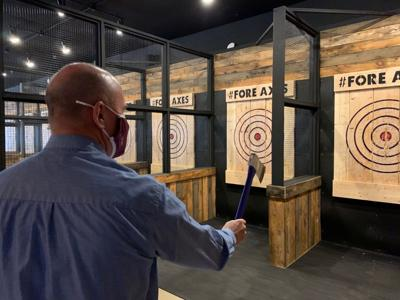 New downtown venue features golf simulators, axe throwing