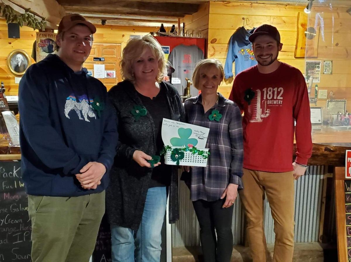 City woman helping Hooley Plunge, one shamrock at a time