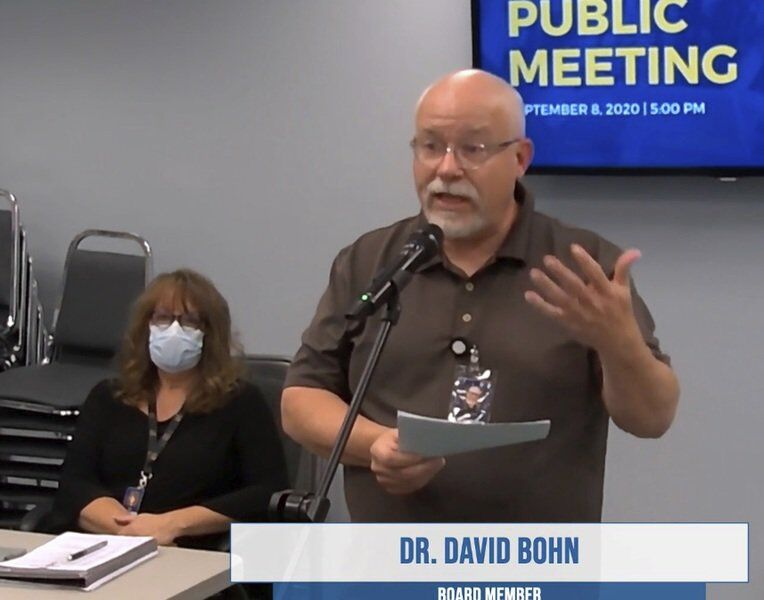 Two school board members not following mask order