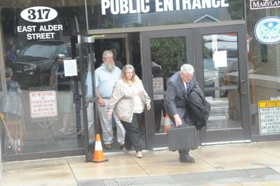 Robert and Brenda Shaffer and Attorney Tully leave Garrett County courthouse 7-25-18