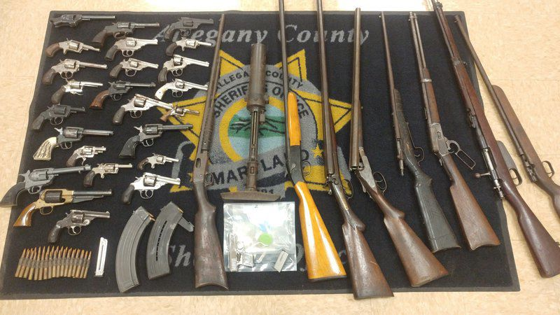 Weapons cache, heroin seized in Williams Road drug raid