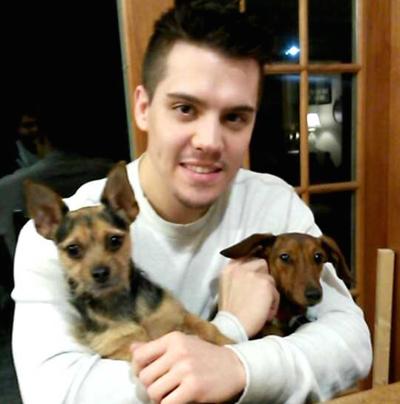 Alexander Stevens holding family pets