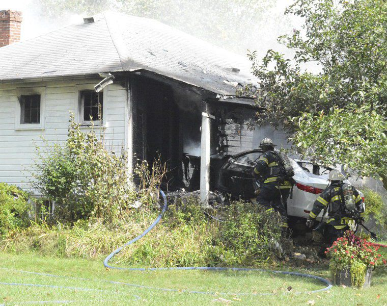 Fleeing vehicle hits house, catches fire