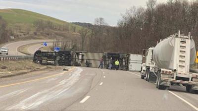 Tractor-trailer overturns on Interstate 68; driver not hurt