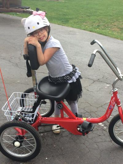 New bike helps local girl with Down syndrome keep up with brother, friends