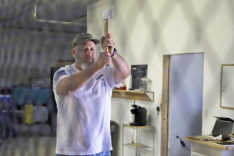Uncle, nephew open indoor ax-throwing range