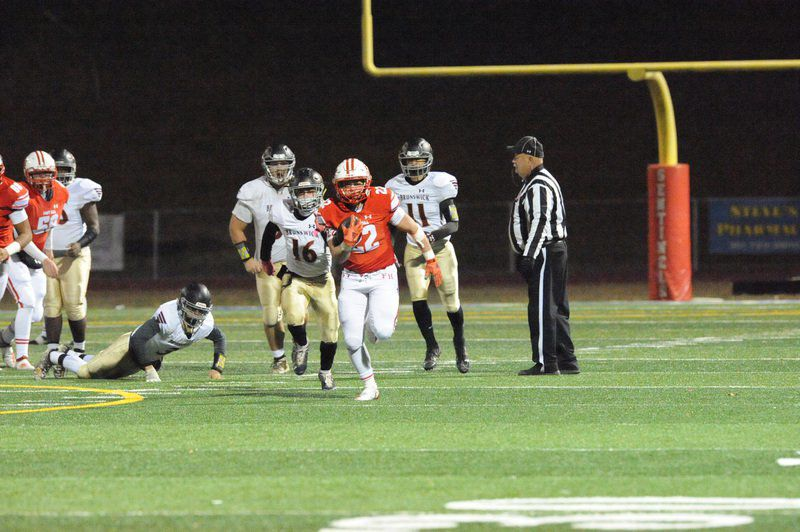 Sentinels derail Railroaders, win playoff opener 35-21