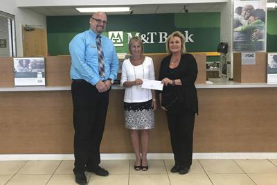 M T Charitable Foundation Donates To Tucker Boulder Park Business