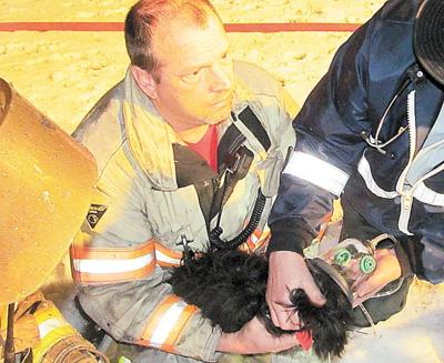 Fire displaces Oakland  family; responders revive pet dog found in closet of home