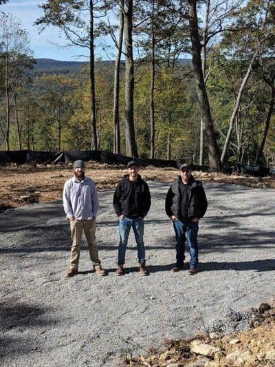 Garrett County father and sons build log cabins and a family legacy