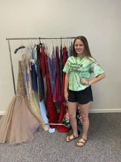 Teen holding charity homecoming dress sale