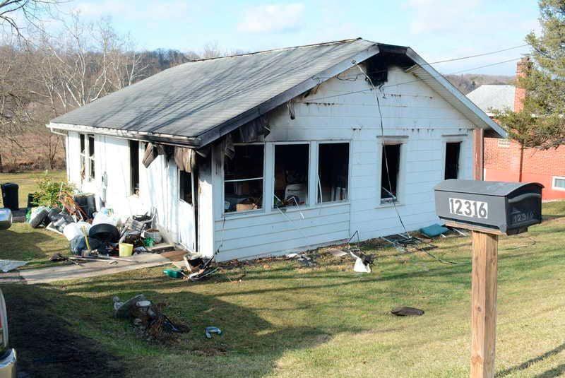 Home burns hours after drug raid