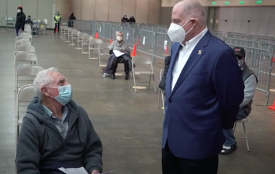 Gov. Larry Hogan tours vaccination clinic at the Baltimore Convention Center