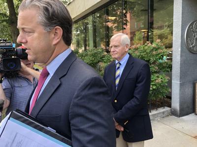 Brooks McArthur addresses news reporters