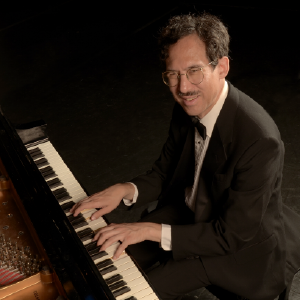 Michael at the piano, leading his jazz quintet
