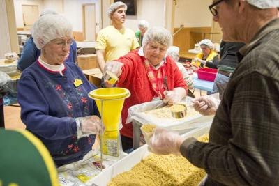 Vermont Lions meet in Barre to pack 10,000 meals