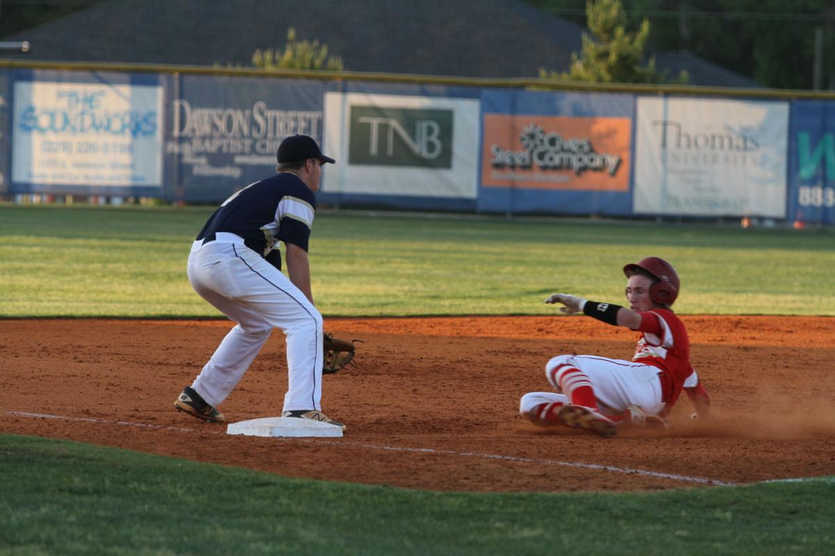 Thomasville s parker zolt slides into third for a triple in the sixth inning with thomas county central s doug smith covering the bag friday night