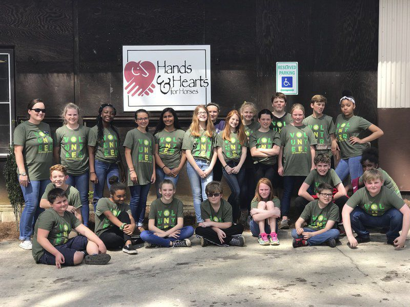 TCMS students have full day of service learning
