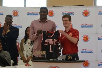 775eb184e Reggie Perry receives McDonald s All-American jersey