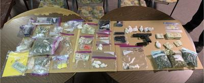 Cairo police find weapons, drugs in two arrests