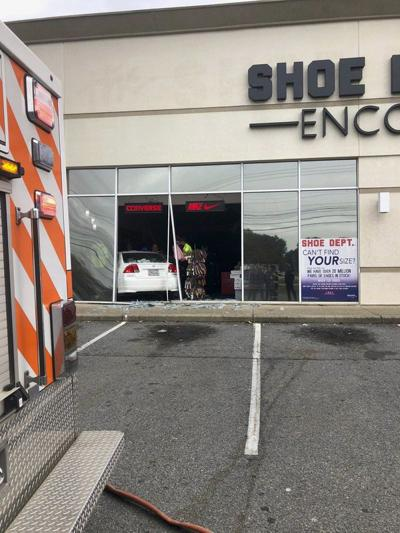 Car jumps curb, crashes into store