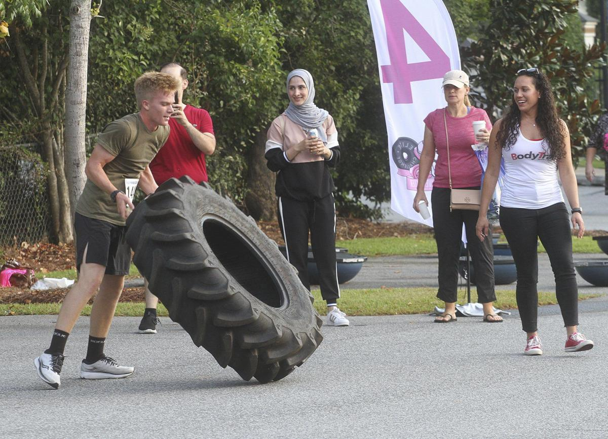 Runners go pink to fight cancer, obesity