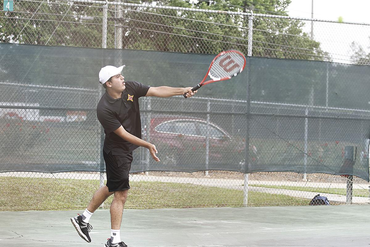 Thomasville s jenil patel serves during a doubles matchup against banks county on thursday