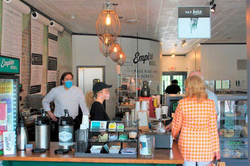 Downtown merchants continue measured approach amid virus surge