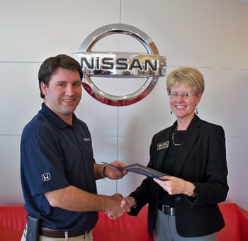David Flowers, Owner Of Flowers Nissan, Accepts The BEE Partner Of The  Quarter Award From Dr. Kathy Keown, Director Of Personnel And Public  Relations For ...