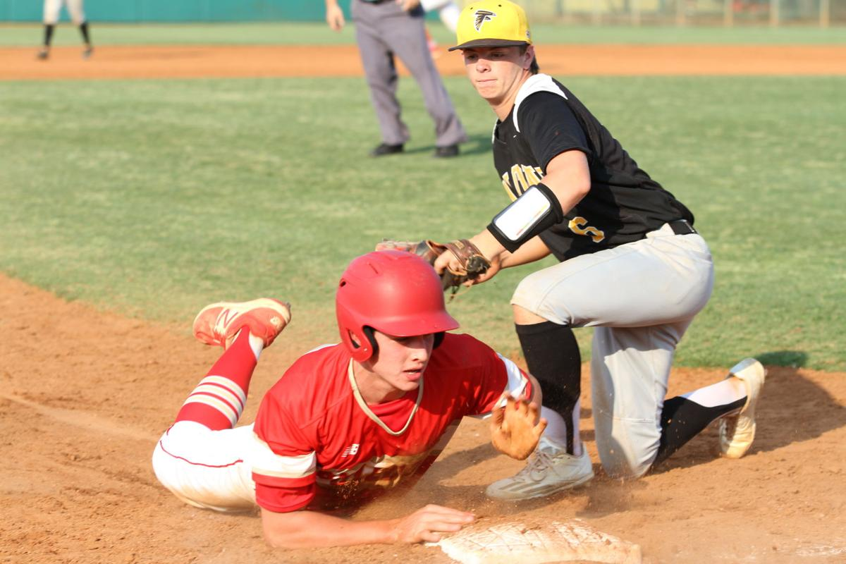 Thomasville s levi knop slides into third base against east laurens on friday