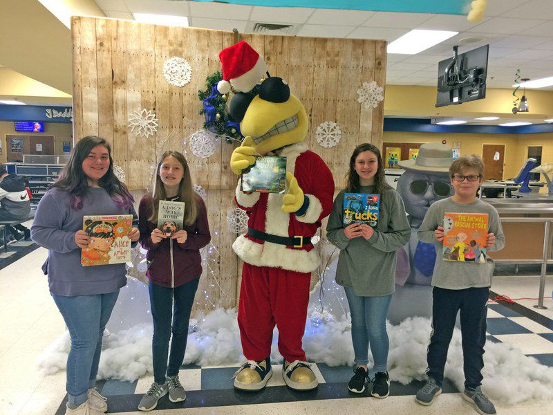 TCMS MERIT students share the gift of warmth