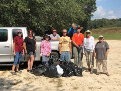 Volunteers take the trash out of the river