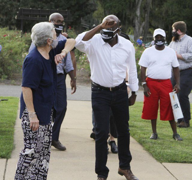 Leading in the polls, Warnock visits Rose City