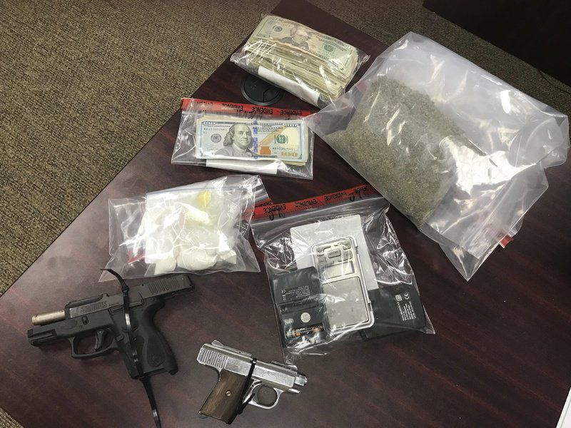 Agents seize drugs, guns, cars in bust