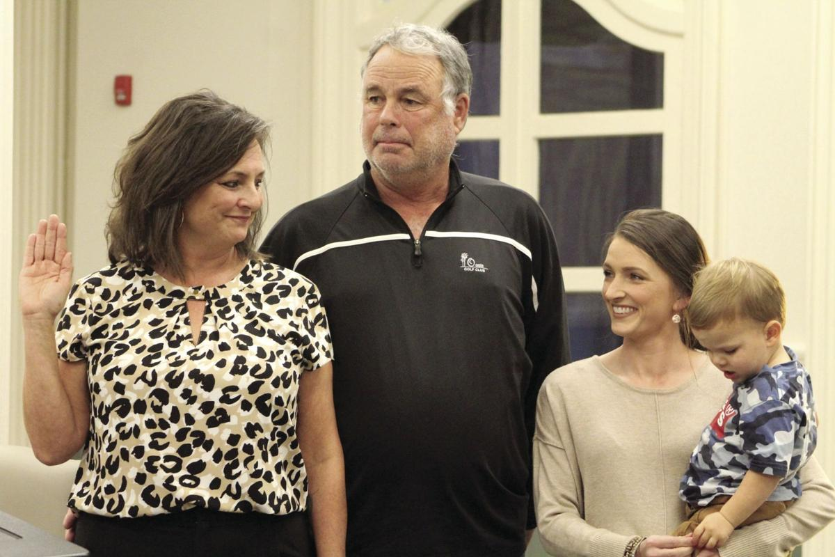 Mayor Julie Smith stands with family during her swearing in on Jan. 6.