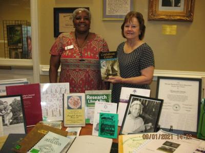 Perida Mitchell presents program to UDC about genealogy resources
