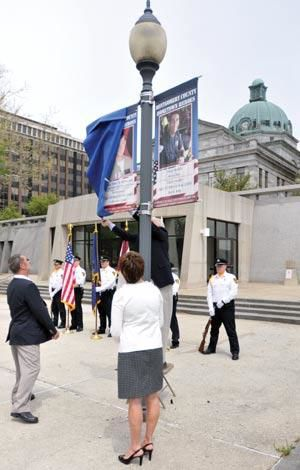 US Coast Guard officer memorialized with courthouse banner (video)