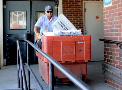 Postal workers provide sense of community normalcy