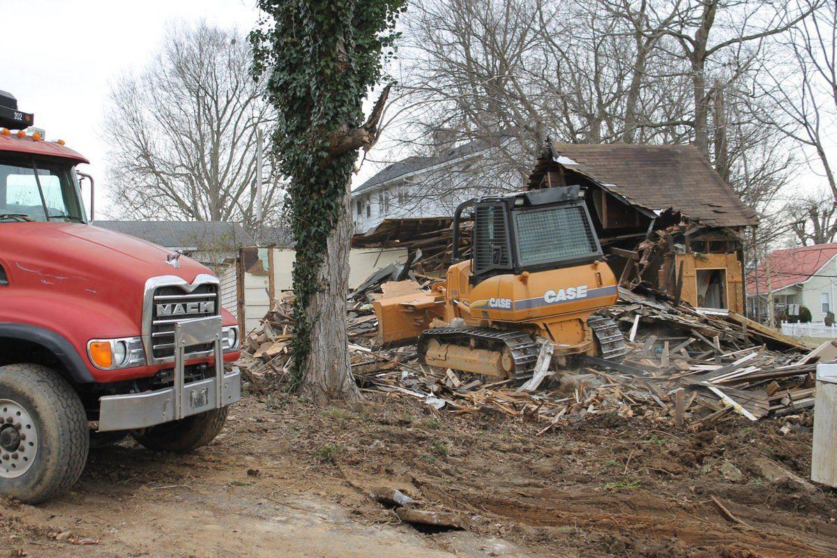 Code enforcement removing blighted houses