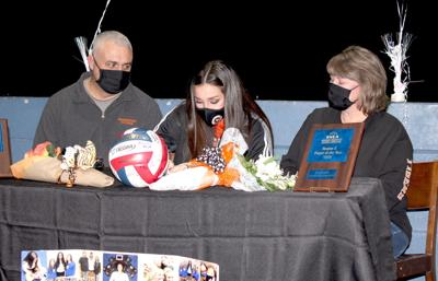 Mitchell signs to play volleyball at Georgetown College