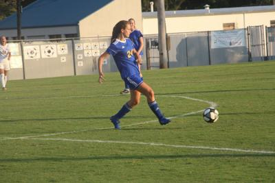 Lady Tigers split games at Christian County