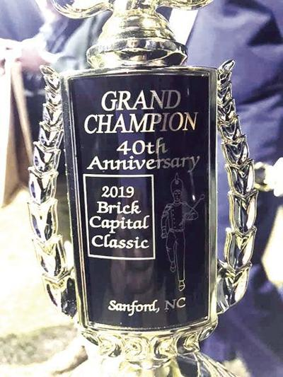 ACHS marching band wins Grand Champion trophy