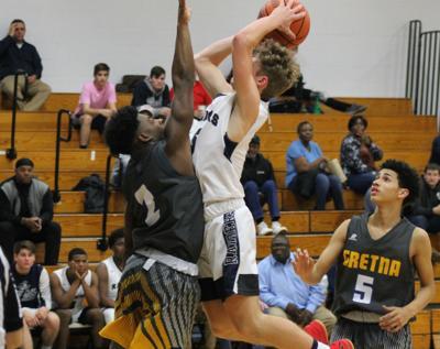 Hawks clip Raiders in boys basketball nailbiter