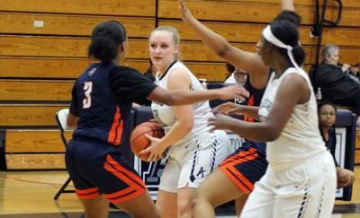 Lady Raiders hold off Heritage comeback attempt