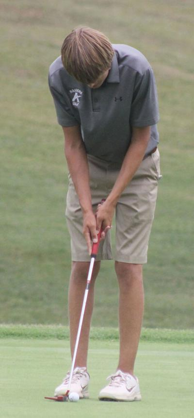 Raiders golf takes Dogwood throne; awaits Monday's regional playoff